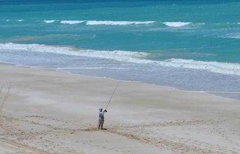 Photo of recreational beach fisher