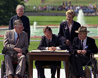 Image of George Bush signing the Americans with Disabilities Act